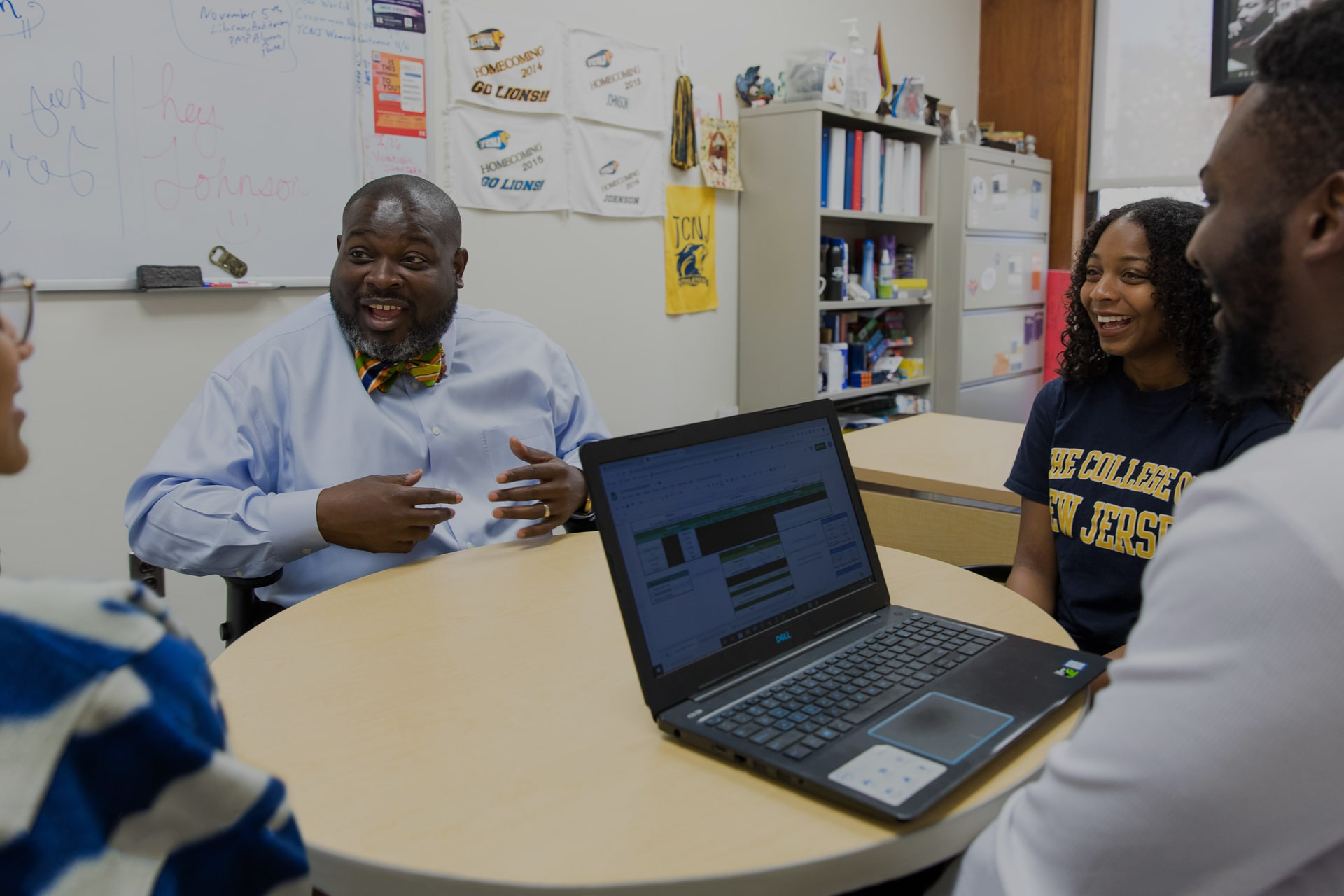 TCNJ staff member working with students